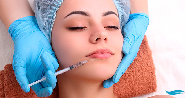 Best Lip Injection Clinic In Toronto: What Are Your Options? | Woman getting lip injection | Jiva Spa Toronto anti aging facials beauty spa salon skin rejuvenation medispa