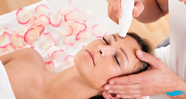 Spa microdermabrasion and home microdermabrasion | lady receiving microdermabrasion on forehead | Jiva Spa Toronto anti aging facials beauty spa salon skin rejuvenation medispa