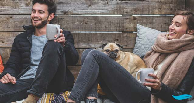 Taking some time for healing and relaxation | guy and lady laying on the ground with a dog as company | Jiva Spa Toronto anti aging facials beauty spa salon skin rejuvenation medispa