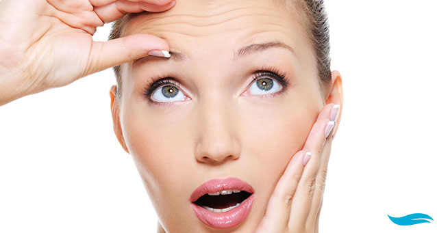 Solutions for anti aging and what to do with wrinkles   lady flapping her hair in front of the sun   Jiva Spa Toronto anti aging facials beauty spa salon skin rejuvenation medispa